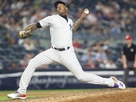 Jul 3, 2018; Bronx, NY, USA; New York Yankees pitcher Aroldis Chapman (54) pitches in the ninth inning against the Atlanta Braves at Yankee Stadium.