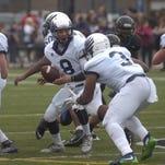 Sophomore quarterback JDrew McGovern hands the football to senior fullback David Reese.