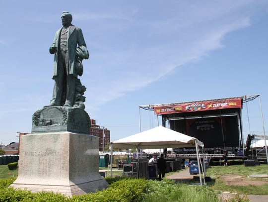 The statue of James A. Bradley watches over Asbury