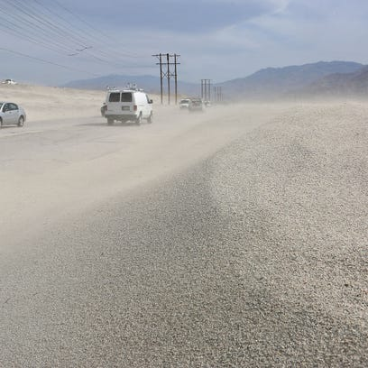 Sand whipped up by the wind pelts drivers travelling