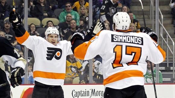 Brayden Schenn, left, got an extension on the three-year anniversary of being traded to the Flyers.