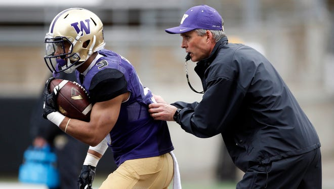 Washington Huskies head coach Chris Petersen (right) and running back Myles Gaskin are two reasons the Huskies are considered College Football Playoff contenders in 2017.