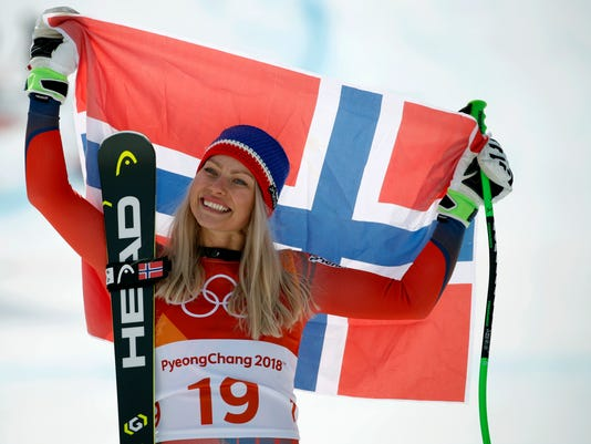 Norway's Ragnhild Mowinckel celebrates winning the silver medal during the flower ceremony for the women's downhill at the 2018 Winter Olympics in Jeongseon, South Korea, Wednesday, Feb. 21, 2018. (AP Photo/Christophe Ena)