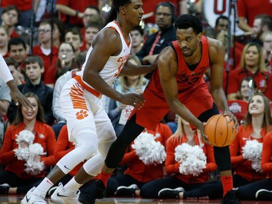 Ohio State's Keita Bates-Diop, right, posts up against Clemson's Donte Grantham during the first half of an NCAA college basketball game Wednesday, Nov. 29, 2017, in Columbus, Ohio. (AP Photo/Jay LaPrete)