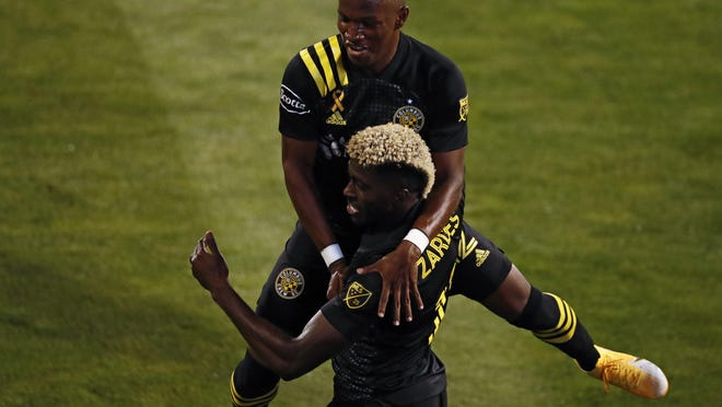 Crew forward Gyasi Zardes, foreground, celebrates with midfielder Luis Diaz after scoring the first of his two goals against FC Cincinnati on Saturday at Mapfre Stadium. Both players came on as subs in the second half, igniting the offense.