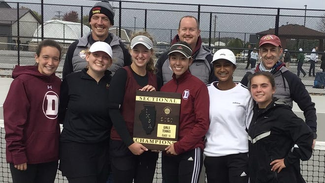 The Dunlap girls tennis team poses with the sectional plaque after winning the Class 1A Geneseo Sectional championship -- the program's third consecutive sectional title.
