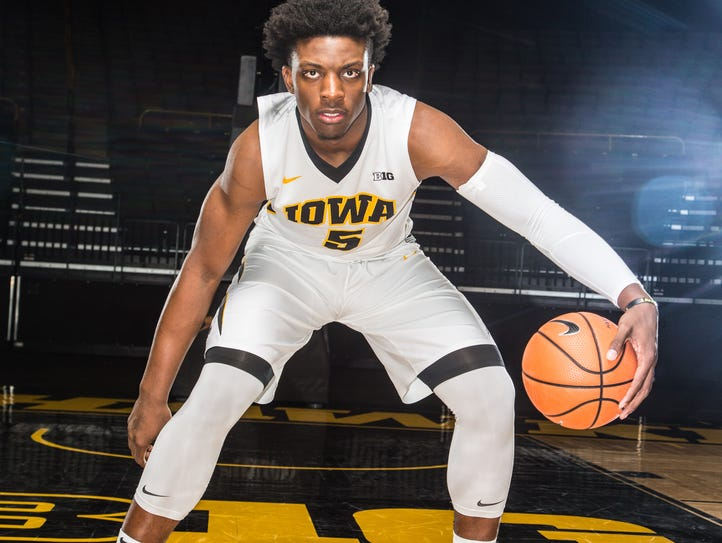 Iowa's Tyler Cook dribbles the ball during media day