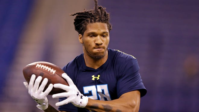 UW cornerback Sidney Jones makes a catch as he runs a drill at the NFL scouting combine earlier this month in Indianapolis. Jones was later hurt at the Huskies' pro day.
