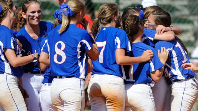 Macon East's Cameron Redding, right, is congratulated by teammates after hitting a walk off state championship winning home run against Springwood during the AISA State Softball Tournament at Lagoon Park in Montgomery, Ala. on Saturday May 3, 2014.