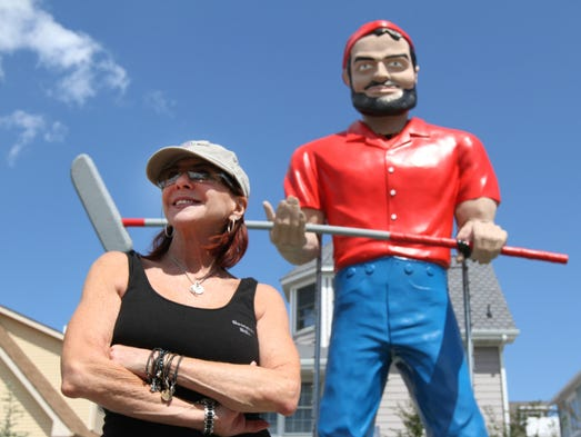 JoAnn Petruzel, owner Barnacle Bill's in Ortley Beach, stands by iconic statue that survived Sandy at her minature golf course, during Memorial Day Weekend. Sunday May , 25, 2014, Toms River  Photo by Robert Ward