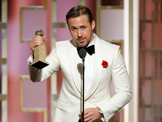 Ryan Gosling accepts an award during the 74th Golden