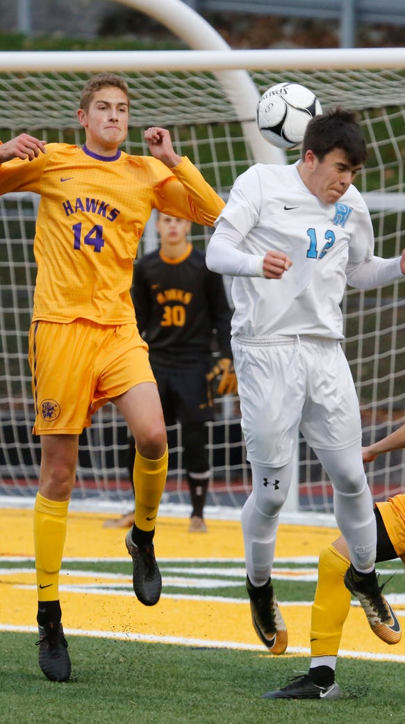 Rhinebeck's Colin Murray (15) battles with Rye Neck's