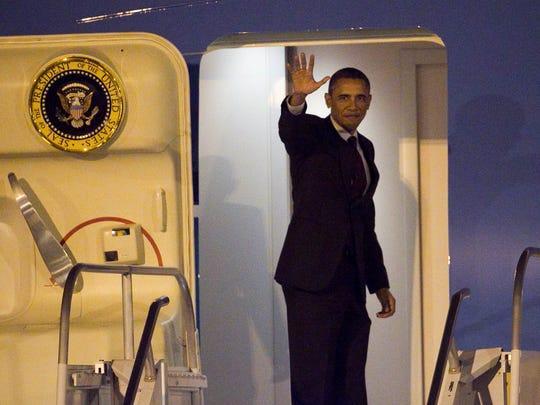 President Barack Obama waves before departing on Air