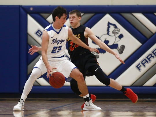 Bondurant-Farrar senior Jordan Collins tries to get around Carlisle junior Jace Vollstedt in a Feb. 9 game. Collins had 9 points in the Blue Jays' loss to Ballard Thursday in a substate semifinal.