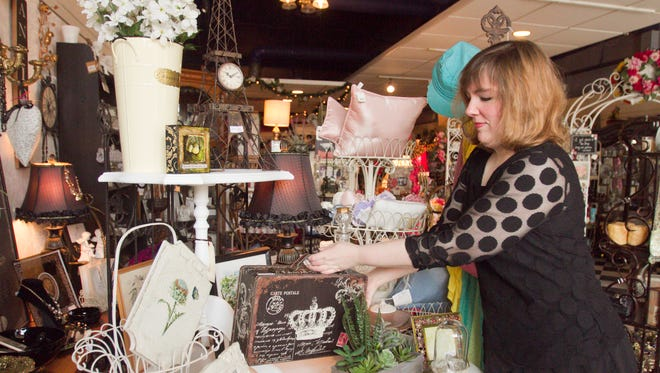 """Amber Sears, owner of Modern Vintage, a boutique store in downtown Brighton, prepares merchandise for a metamorphosis of her business, which will carry much the same products under the name """"The Junktique."""""""