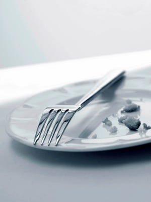 Fork and crumbs left on plate.