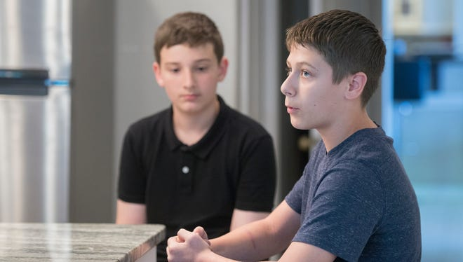 Bailey Middle School seventh-grader Thomas Kellenberger, left, listens as classmate and best friend Logan Perez discusses his Heimlich maneuver technique at the Perez home in Pensacola on Tuesday, April 17, 2018.  Perez performed the Heimlich maneuver and saved Kellenberger from choking during lunch at school recently.