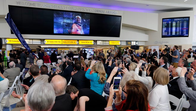 A new sign is unveiled during a celebration for the renaming of Port Columbus International Airport to John Glenn Columbus International Airport on June 28, 2016, in Ohio.