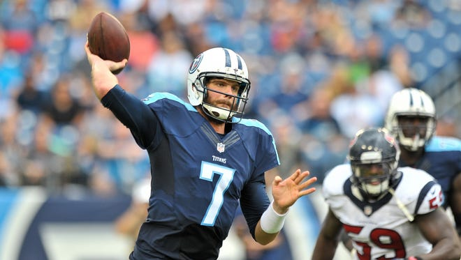Tennessee Titans quarterback Zach Mettenberger (7) passes against the Houston Texans during the second half at Nissan Stadium.