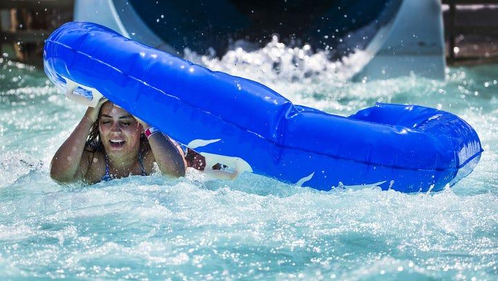 Tanya Jordan, 22, of Mesa, gets underneath her raft