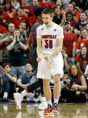 Louisville's Rya McMahon celebrates after knocking down two 3-point shots in a row.  