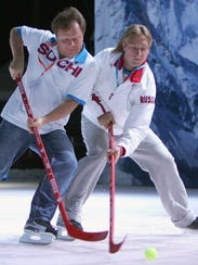 Russian jazz saxophonist Igor Butman plays hockey with