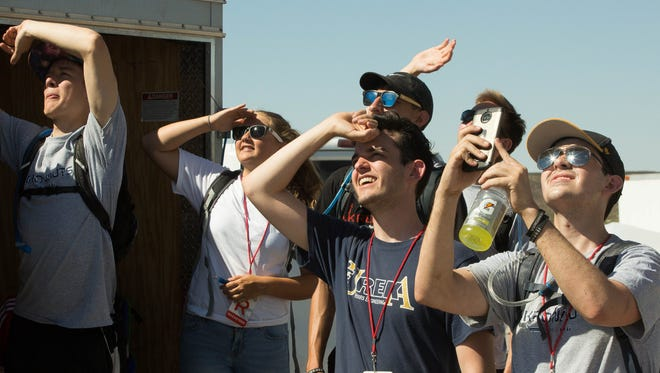 Members of the University of Akron's rocket team watch fellow competitors' rockets launch, Friday June 22, 2018 during the Spaceport America Cup.
