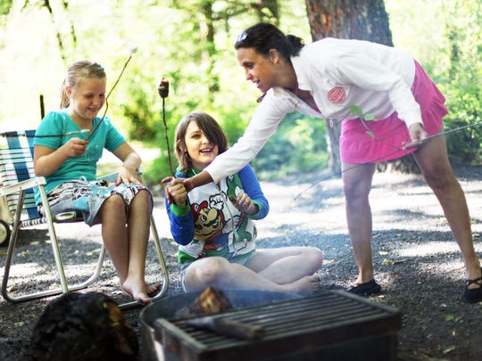 An additional 1,000 campsites within the path of next August's total solar eclipse — including at North Santiam State Park, seen here — will be opened and available to reserve at Oregon's state parks. Pictured here is Paula Montague-Smith of Salem to her daughters Jascelyn, 13, and Makara Montague, 9.
