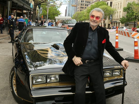 """FILE - In this March 12, 2016 file photo, Burt Reynolds sits on a 1977 Pontiac Trans-Am at the world premiere of """"The Bandit"""" at the Paramount Theatre during the South by Southwest Film Festival in Austin, Texas.  Hundreds of fans in Trans Ams made it to Atlanta to celebrate the 40th anniversary of """"Smokey and the Bandit."""" About 350 cars retraced actor Burt Reynolds' wild ride from the Texas-Arkansas line to Atlanta in the movie that roared into pop culture in 1977.  (Photo by Jack Plunkett/Invision/AP)"""
