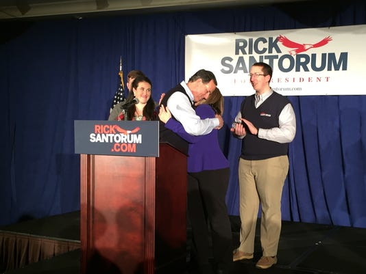 635899663098945752-Santorum-hugs-wife-Karen-Feb.-1-2016.jpg