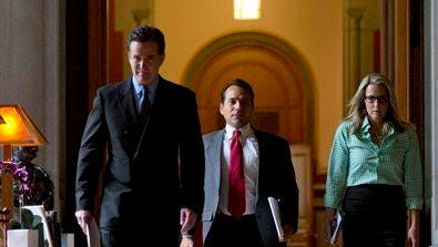 Senate Majority Leader John Flanagan, R-Smithtown, left, walks to a meeting in Gov. Andrew Cuomo's office at the Capitol with Robert Mujica, chief of staff, and communications director Kelly Cummings, Wednesday, May 13, 2015, in Albany, N.Y. (AP Photo/Mike Groll)
