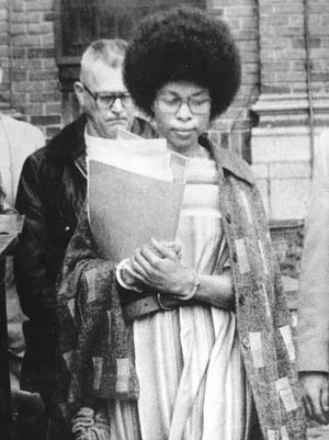 - - (CHESIMARD) New Brunswick, NJ. - FILE PHOTO- Joanne Chesimard of the Black Liberation Army leaves the Middlesex County Courthouse after Superior Court Judge Theodore Appleby added 26 years to 33 to life sentence she was serving. -Dick Costello