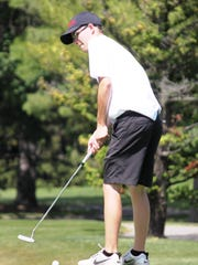 Milford's Christian Golich takes aim with a putt during the Division 1 boys golfs finals at Forest Akers.