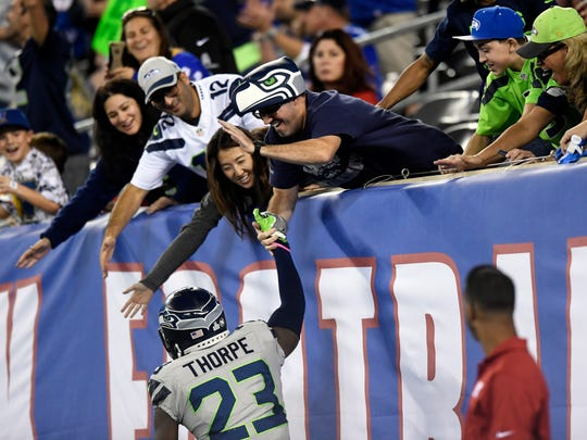 Seattle Seahawks defensive back Neiko Thorpe (23) celebrates with fans after the fourth quarter touchdown puts the Seahawks 24-7 over the New York Giants on Sunday, October 22, 2017 in East Rutherford, NJ.