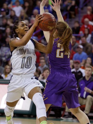 Milwaukee Academy of Science's Shemera Williams drives to the hoop past Clayton's Kailey Ketz during the 2017 WIAA state tournament.