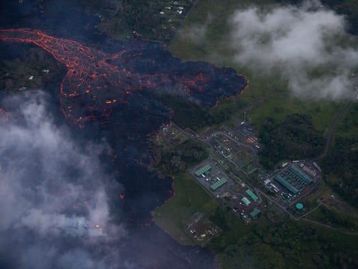 A flow of lava moves to the doorsteps of the Puna Geothermal