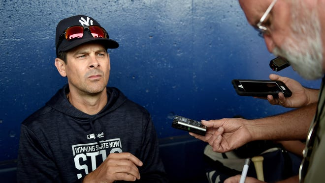 New York Yankees manager Aaron Boone (17) fields questions from reporters before a spring training game against the New York Mets at First Data Field.