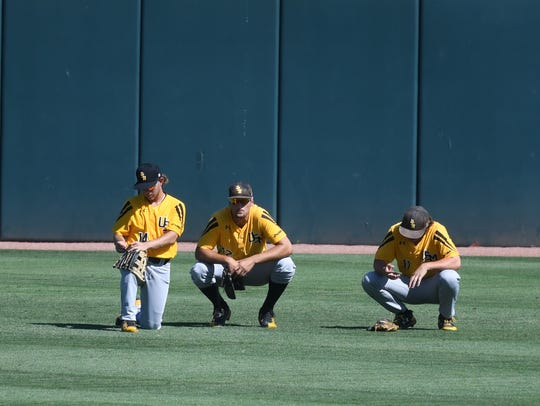 Southern Miss outfielders, from left, Gabe Montenegro,