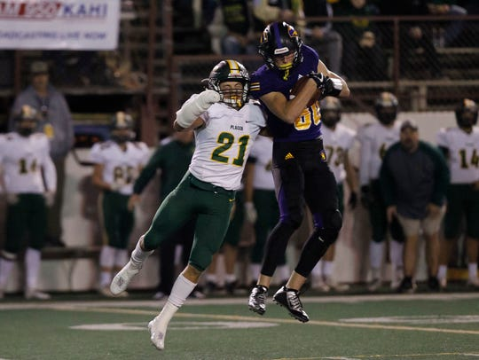 Salinas' Jeffrey Weimer catches the pass over Placer's