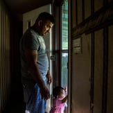 Abednego de la Cruz with his daughter Jazlyn, 10 months old, in their Chattahoochee, Fla., home on Saturday, July 1, 2017. De la Cruz was injured while working for a  company that hired him without verifying his documents. After his injury, he was fired and left without further medical care. He is currently waiting for a decision on the appeal he filed after he was denied asylum to stay in the U.S..