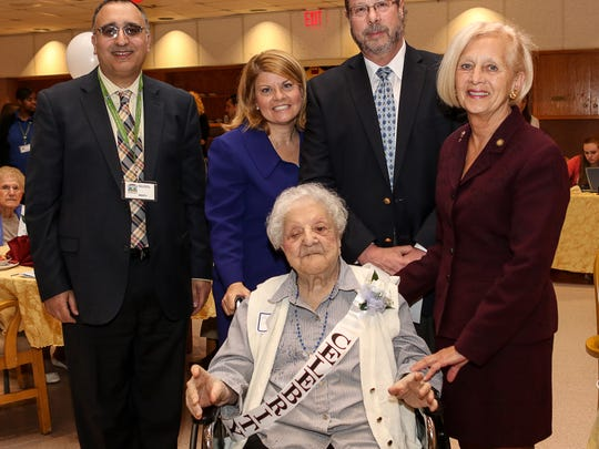 Angelina Sangregorio (front center) was the oldest of the centenarians present at 105 during Somerset County's Centenarian Recognition Luncheon hosted by Regency Jewish Heritage Center in Somerset on May 20. She is with (from left) Marty Bengio, Regency Jewish Heritage Center administrator, Joanne Fetzko, executive director of the Somerset County Office on Aging and Disability Services, Michael Frost, deputy director of Somerset County Human Resources, and Patricia Walsh, deputy director of the Somerset County Board of Chosen Freeholders.