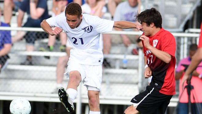 Johnston's Darius Doswell (21) drives the ball across field as  Linn-Mar's Noah Ajram (17) defends on Friday, June 5, 2015, during the 2015 Boys State Soccer Championship held at the Cownie Soccer Park.