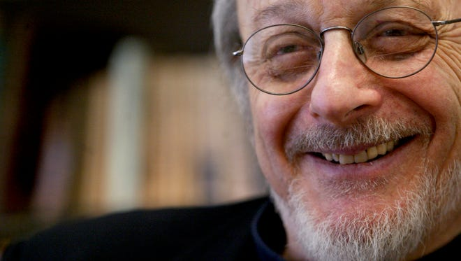 In this April 27, 2004, file photo, author E.L. Doctorow smiles during an interview in his office at New York University.