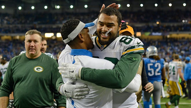 Green Bay Packers tight end Richard Rodgers gets a hug from a Detroit Lions staff member after Rodgers made a Hail Mary catch against the Detroit Lions to win the game Thursday night's game at Ford Field in Detroit, Mich.