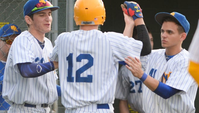 Northern Lebanon's Isaac Wengert is congratulated by Noah Gingrich (left) and Hayden Johnson (right) after scoring as Lebanon downed Northern Lebanon 2-1 in 10 innings at Earl Wenger Field in Fredericksburg on Tuesday, May 3, 2016.