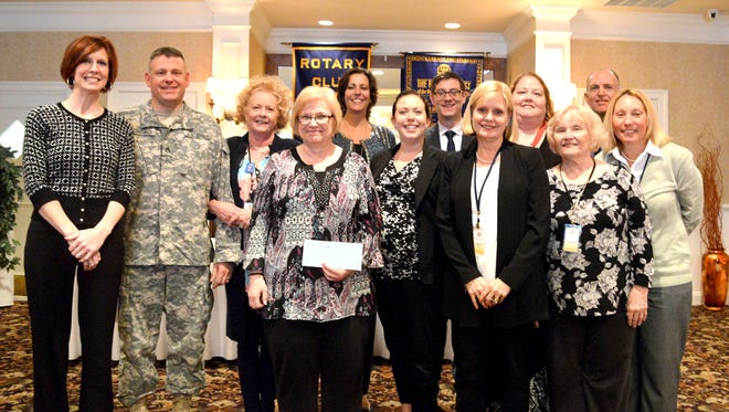 Pictured, from left, are: Kelly Rebert, president of the Rotary Club of Hanover President; Jason Fortino, of the National Guard; Carol Connor; Carol Hinkle, of Ruth's Harvest; MaryBeth Hockenberry; Justine Trucksess; Torren Ecker; Chris Neri; Kim McBride; Donna Haar; Ralph Jodice; and Cheryl Paulin.