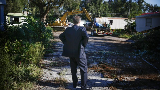 Indianapolis Mayor Joe Hogsett watches as an excavator demolishes Grandma Lloyd's Mobile Home Trailer Park on Sept. 19, 2016.