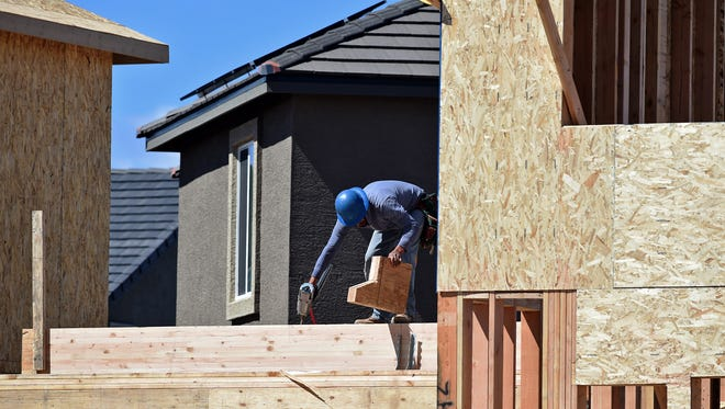 Construction at a housing project in Sparks. Construction is one of the sectors driving Nevada's economic recovery from the recession.