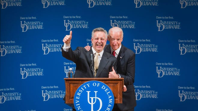 KYLE GRANTHAM/THE NEWS JOURNAL Former Vice President Joe Biden jokes with University of Delaware President Dr. Dennis Assanis as he grabs him by the shoulder during a ceremonial opening of the new Biden Institute at the University of Delaware's Roselle Center for the Arts in Newark on Monday afternoon. Former Vice President Joe Biden jokes with University of Delaware President Dr. Dennis Assanis as he grabs him by the shoulder during a ceremonial opening of the new Biden Institute at the University of Delaware's Roselle Center for the Arts in Newark on Monday afternoon.
