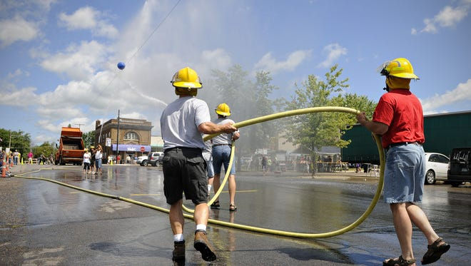 The Albany Fire Department battles the Albany Jaycees during the water ball fights at the 2012 Albany Heritage Day.